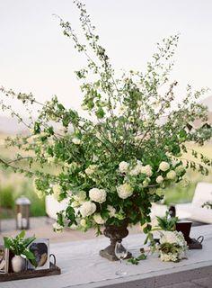 floral centerpieces, escort table, flower centerpieces, table arrangements, white weddings, white wedding flowers, floral arrangements, green flowers, center table