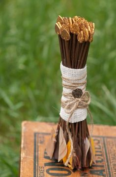 arrow bouquet.  PLEASE VOTE FOR ME!!!! Hunger Games Wedding Inspired Competition. http://weddingandeventinstitute.com/the-wedding-games/section/district10/ - - repin from district 10 in The Wedding Games