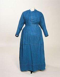 Maid's Dress, 1880.  England. Servant dress in a dark blue calico with small white dots.