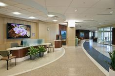 Concierge desks at Regions Hospital in St. Paul, Minn., are open and welcoming to improve personalized contact upon patient arrival, while self-service kiosks offer options for expedited check-in | Designing For The Patient Experience | Healthcare Design Magazine
