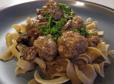 These Creamy Mushroom Meatballs put a twist on your classic spaghetti dinner. This slow cooker meatball recipe incorporates exciting flavors into the ground beef, and a mushroom sauce gives the dish richness and depth.