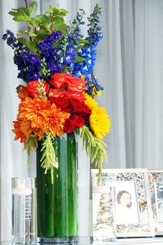 Fun and colorful #centerpiece with a green leaf wrapped vase by Michael Daigian Design. #weddings
