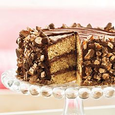 Heavenly Candy Bar Cake | Melted candy bars are stirred into the batter, and more are coarsely chopped and sprinkled over the top.