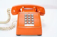 Refurbished Retro Bell Orange Push Button Phone. $58.00 USD, via Etsy.