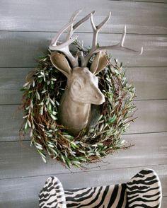 love the wreath around that beautiful deer head sculpture
