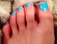 Glittery turquoise pedicure polish