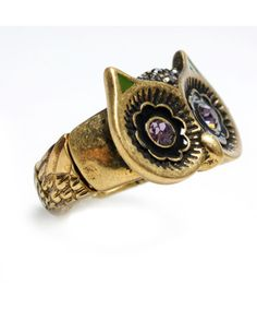 I've been seeing a lot of owl inspired jewelry around lately. And I love it!