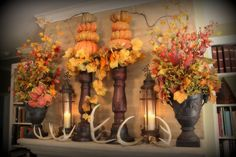 Fall mantle. like the candle sticks with pumpkins.