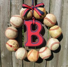 this would be cute to do a combined craft, they had one where the kids first teeball season you put their hand print on the ball and you could combine that craft and make it into a wreath like this...either just for the first season or do it yearly and make it a keepsake either way