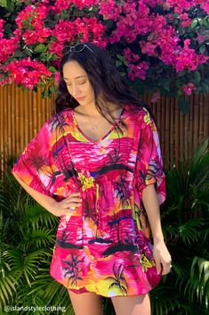 Pink Sunset Kaftan with Lei Set. Soft beach cover up. Throw this delightful caftan over your bikinis or jeans for a day at the beach, cruising or casual wear. Lots of colours and patterns to choose from. #poncho #kaftan #bikini #beachcoverup #caftan #hibiscusparty #luau #luauparty #coverup #beachwear #cruise #cruisewear #luau #luauparty #luaupartycostume #fancydress #luaudress #hawaiiancostume