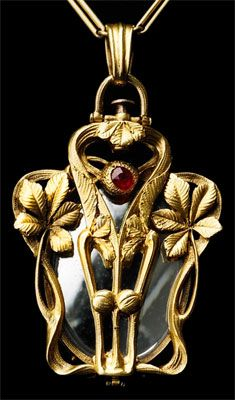 ART NOUVEAU  Rare Chesnut Pendant. Gold Ruby.1895  This pendant opens from the top, enabling it to also be worn fully open, revealing it's mirror.  Vivienne Becker, 1985