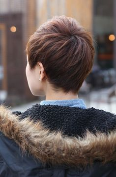 Really thinking about a new summer cut.  Back View of Short Layered Boyish Cut - 2013 Pixie Cut