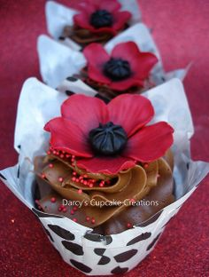 poppy cupcakes by Darcy's Cupcake Creations, via Flickr