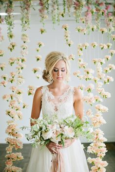 floral backdrop, photo by Lindsey Orton Photography http://ruffledblog.com/romantic-floral-inspiration-shoot #weddingideas #backdrops