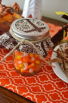 Candy corn in jars at a Thanksgiving party.  See more party ideas at CatchMyParty.com.  #thanksgivingpartyideas