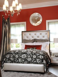 This room shows the possibility of placing a bed in front of two windows. Though it is not the ideal location using your draperies to frame the space make the bed look like it belongs. The mirror above draws the eye up and reflects the glow of the chandelier. (HGTV Designer's Portfolio)