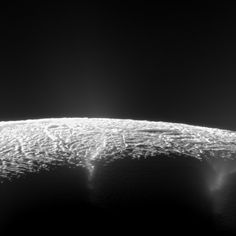 This dramatic view looks across the region of Enceladus' geyser basin and down on the ends of the Baghdad and Damascus fractures that face S...