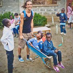 Who needs a car when you've got a Wheelbarrow! (Louis Cole at a children's home in Kenya)
