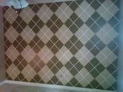Accent wall painted in an argyle pattern