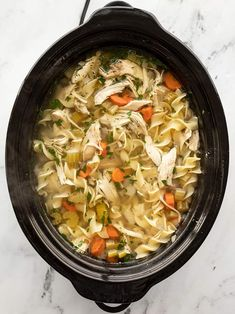 Slow cooker chicken noodle soup is an incredibly easy and soothing winter recipe that will fill you up and warm you from the inside out! BudgetBytes.com
