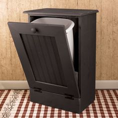 Disappearing Trashcan. I found a site that has instructions on how to make one of these, well I dont know if it is a trash can cabinet but I know I could find a way, haha I don't know if this blog sends you to a DIY site. But it'd be very cute in the kitchen and less stink!