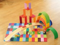 Wooden Toy Bridge pairs with Grimm's wooden blocks and wooden toy cars. Colorful and imaginative fun! From Bella Luna Toys.