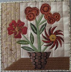 """Folk Art Flowers, 12 x 12"""", by Annette Guerrero.  The flower pot is sitting within an attic window block."""