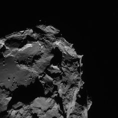 The Rosetta navigation camera sent back this image of Comet 67P/Churyumov-Gerasimenko on Aug. 23, showing about a quarter of the four-kilometer (2.5-mile) comet. This image was acquired from a distance of 61 kilometers (38 miles). Credit: ESA/Rosetta/NAVCAM