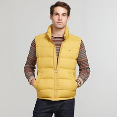 Tommy Hilfiger men's outerwear. Our puffy down vest will help you stay warm and toasty without the bulk. Rolled up it packs down to almost nothing.• Slim fit.• Body 100% nylon. Filling 75% down 25% feathers.• Two interior pockets, drawstring at hem, deep front snap pockets.• Machine washable.• Imported.