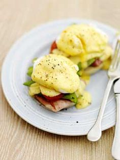 Eggs benedict with avacado and tomato...YUMMY