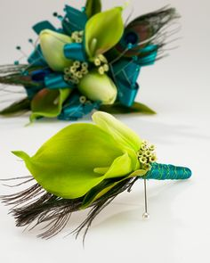 A lovely color combo! Calla Lily & Peacock Feather Boutonniere with decorative Corsage Pin