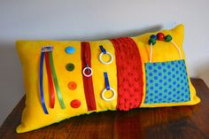 Yellow activity pillow for those with Alzheimer's or other dementia.