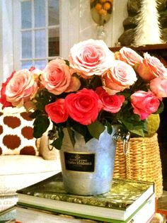 Pink roses in a vingage champagne ice bucket.