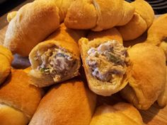 Rattlesnake Bites ~1 lbs ground beef, browned. 4 jalepenos, deveined & deseeded, 1 small can of diced green chilies. 1/2 onion diced. 1 8 ounce cream cheese. 1/4 tsp Cumin. 1/2 teaspoon Red Pepper. Salt & Pepper to taste. 3 cans crescent rolls. Brown ground beef & drain. Add onion, chilies & jalepenos. Cook til veggies are tender. Add in spices. Turn off heat & stir in cream cheese. Put 1 tbsp of mixture at wide end of crescent roll & roll up. Bake on ungreased cookie sheet for 11 min at 375 ground beef roll ups, crescent rolls