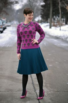 Already Pretty outfit featuring skull sweater, pleated teal skirt, charcoal tights, statement necklace, pink patent pumps