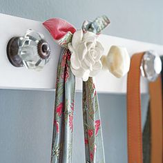 "Organize everyday items | Problem: I always misplace accessories....Create a row of beautiful knobs. Keep purses, belts or necklaces in order and easily visible. Cut a 1"" x 3"" strip of wood to the desired length, give it several coats of paint in a matching or contrasting color, then screw in knobs and attach it to the wall."