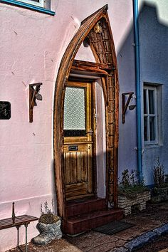 Repurpose old Boat into decorative doorway - I could also see this as a garden gate entrance