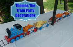 Thomas the Train Party decorations - DIY birthday party table decorations perfect for any train party.  These easy to create food trains will be sure to impress even the smallest engineer