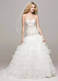 This ruffled skirt ball gown takes bridal glamour and sophistication to the next level!  Strapless sweetheart bodice features delicate beaded lace detail.  Lace-upback shapes a flattering silhouette while ensuring the perfect fit.  Eye-catching and dramatic ruffled skirt adds dimension and finishes of the look.  Chapel train. Sizes 0-14.  Available in Ivory online and in stores. White available in store by special order.  Petite: Style 7V3665. Sizes 0P- 14P.  Special order only. Woman: ...