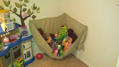 Stuffed animal hammock made out of a twin size fitted sheet.