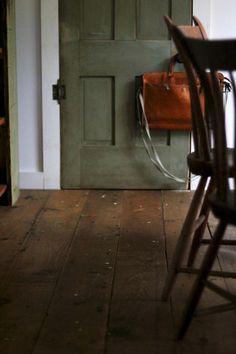 Colour story. Wood floors, green door, that bag.