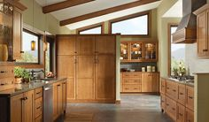 THIS ROOM FEATURES: Merillat Masterpiece® Mesa in Oak Chocolate with Mocha Glaze