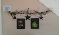 Super easy! Use curtain rod, stars, garland, twine & picture frames.