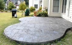 Stamped concrete- in place of our front flower garden. Goodbye weeds!