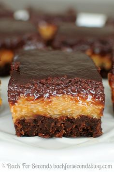 German Chocolate Brownies - Every time I make these, I love them more! http://backforsecondsblog.com #samoas #brownierecipe #dessert #chocolates #sweet #yummy #delicious #food #chocolaterecipes #choco #chocolate