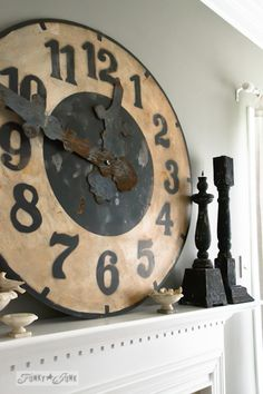 Karen - The Graphics Fairy's house - big rustic clock on fireplace mantel