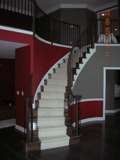 Another good idea for the living room.  Red below the chair rails, gray above, and paint the chair railing white.  Paint the without the chair railing all red.