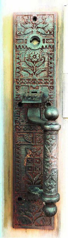 Rusty door handle on old building in Cloverland, Washington