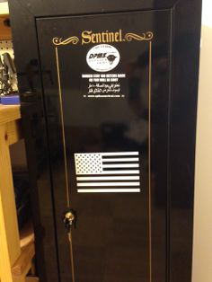 "American flag sticker from www.DecalJunky.com applied to a metal gun locker in this customer's ""Man Cave"""