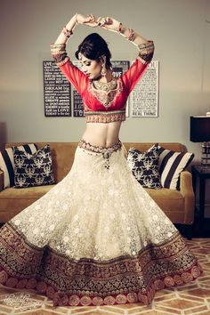 indian bridal lace lengha with short long sleeved red blouse and tikka | Digital Fusion Production - More here - www.indianweddingsite.com/10-maang-tikka-jhoomar-looks/